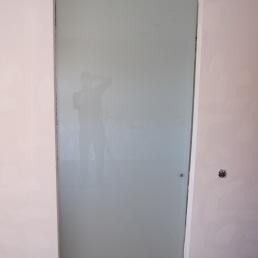 porta bany corredissa vidre